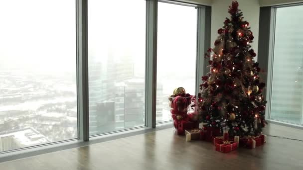 Christmas Tree in the Apartment With Large Windows and Views of the Skyscrapers– stock footage