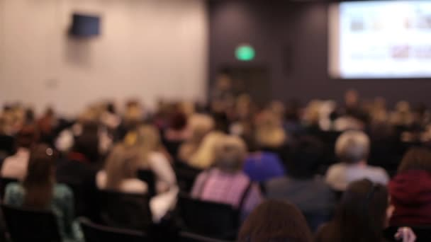 Blurred Conference Room With Crowd of People