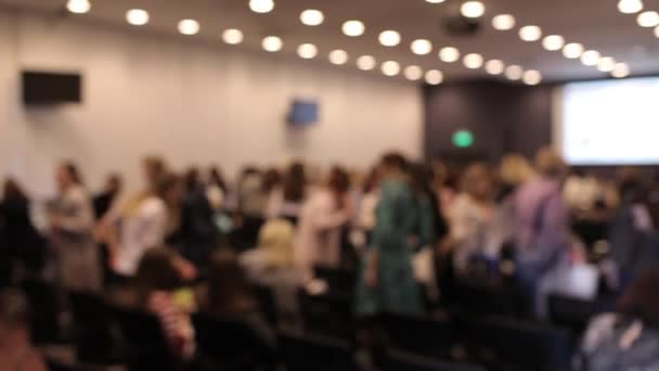 Blurred Conference Room, a Crowd of People Leave the Hall