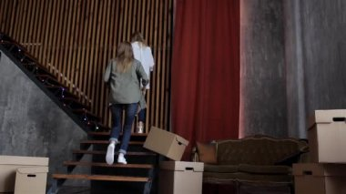 Girls Student Move, Climb up With Cardboard Boxes on the Steps of the Apartment