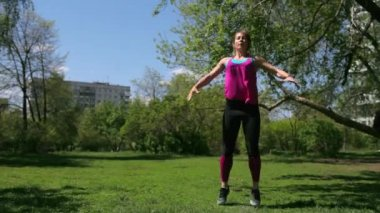 Sports Lifestyle. the Girl is Training in the Park. Sports Woman Doing Strength Training in Nature