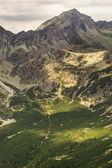 Fotografie High rocky peak Popradske pleso valley in High Tatra Mountains, Slovakia, Europe