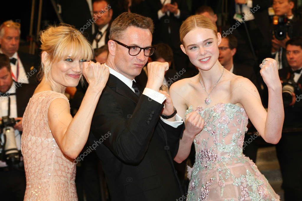 CANNES, FRANCE - MAY 20, 2016: Nicolas Winding Refn, Liv Corfixen, Elle Fanning  attends the 'The Neon Demon' Premiere. 69th annual Cannes Film Festival at the Palais des Festivals stock vector