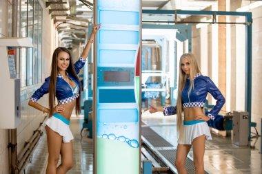Beautiful young girls advertise car wash