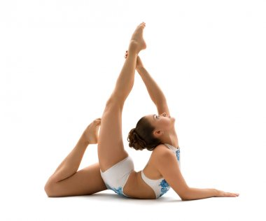 Young girl doing gymnastics studio shot