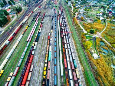 Aerial shoot of railway tracks with lots of colorful train wagons stock vector