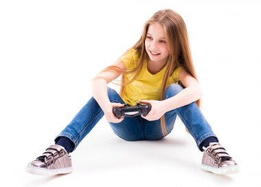 girl playing computer games with a joypad