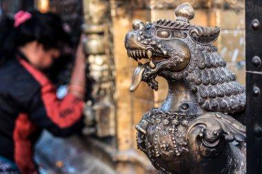 Close-up photo of lion bronze head statue at Bhaktapur Durbar Square, Nepal stock vector