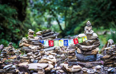 Buddhist Mantra on multicolored flags in himalayas on Annapurna