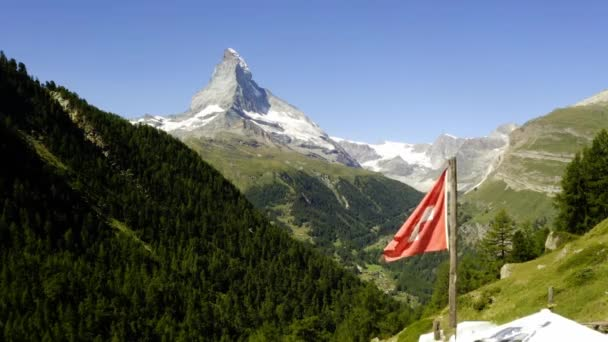 Swiss flag on mountain top