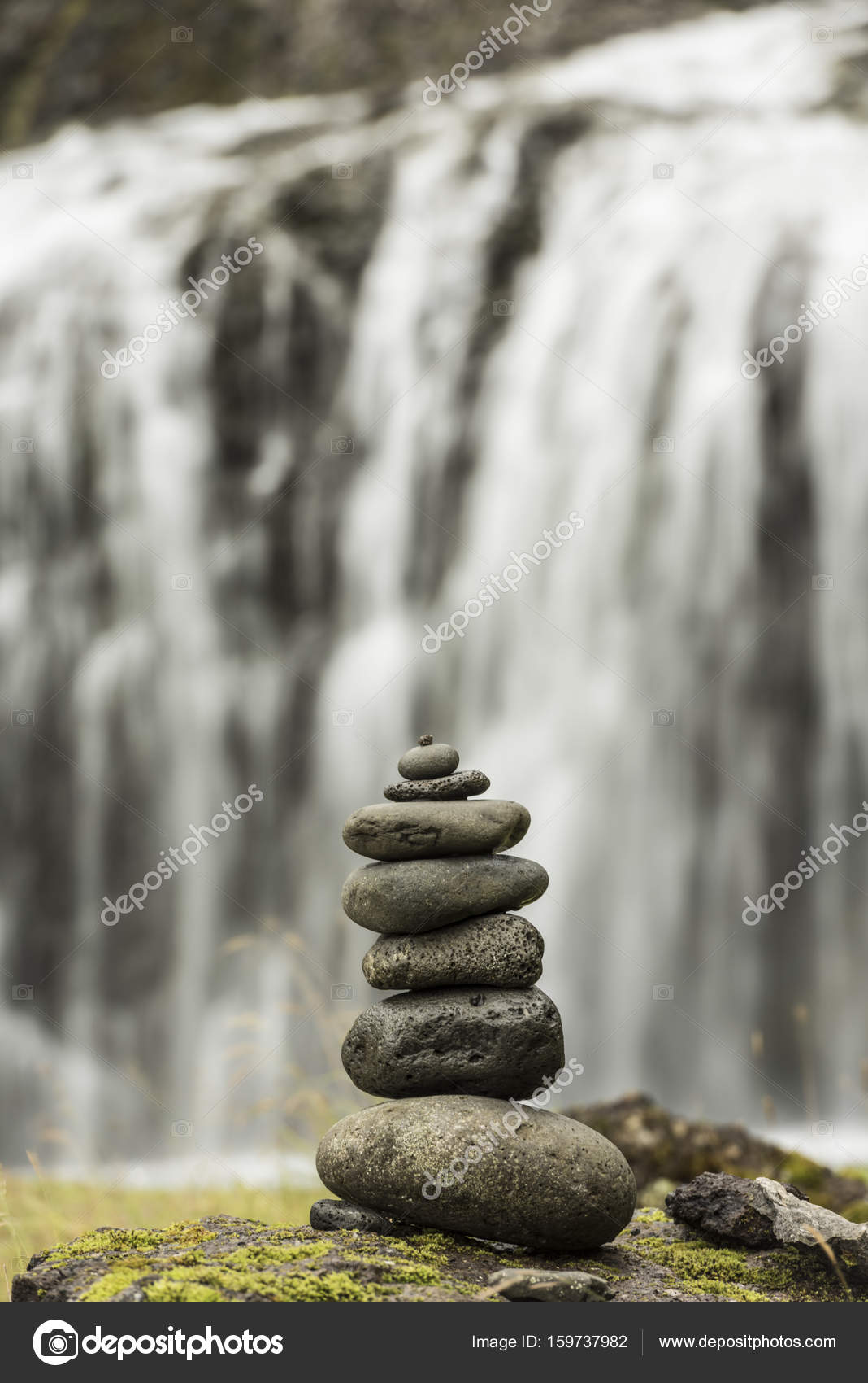 Stack of pebbles and waterfall — Stock Photo © vlue #159737982