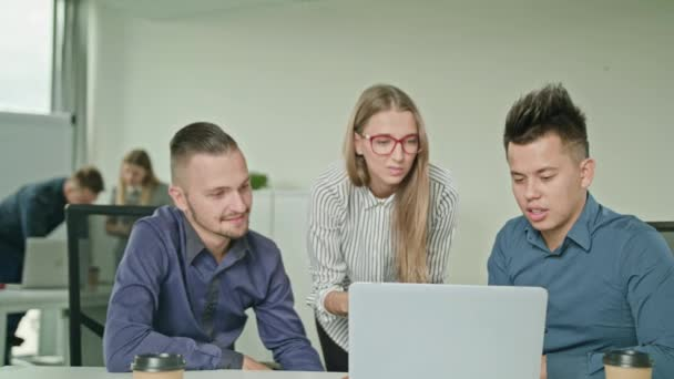 People Group Using Laptop in Modern Startup Office