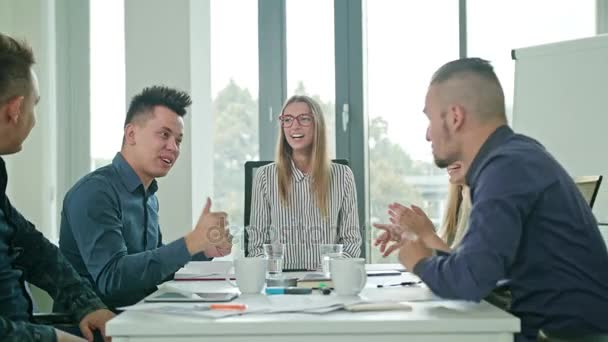 High Fives Members at a Startup in a Modern Office