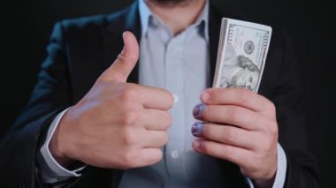 A Man in Black Jacket and White Shirt Holding Cash