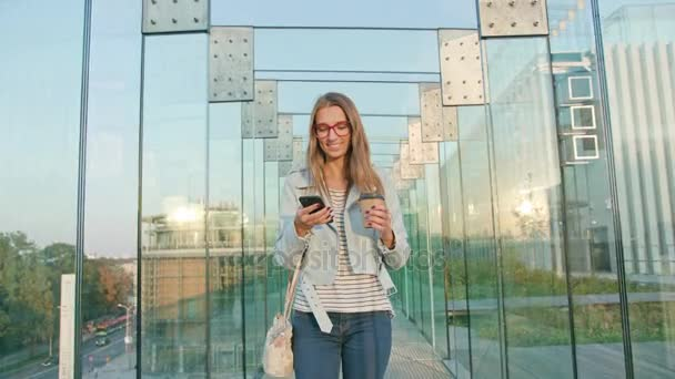 A Young Lady Walking and Using a Phone