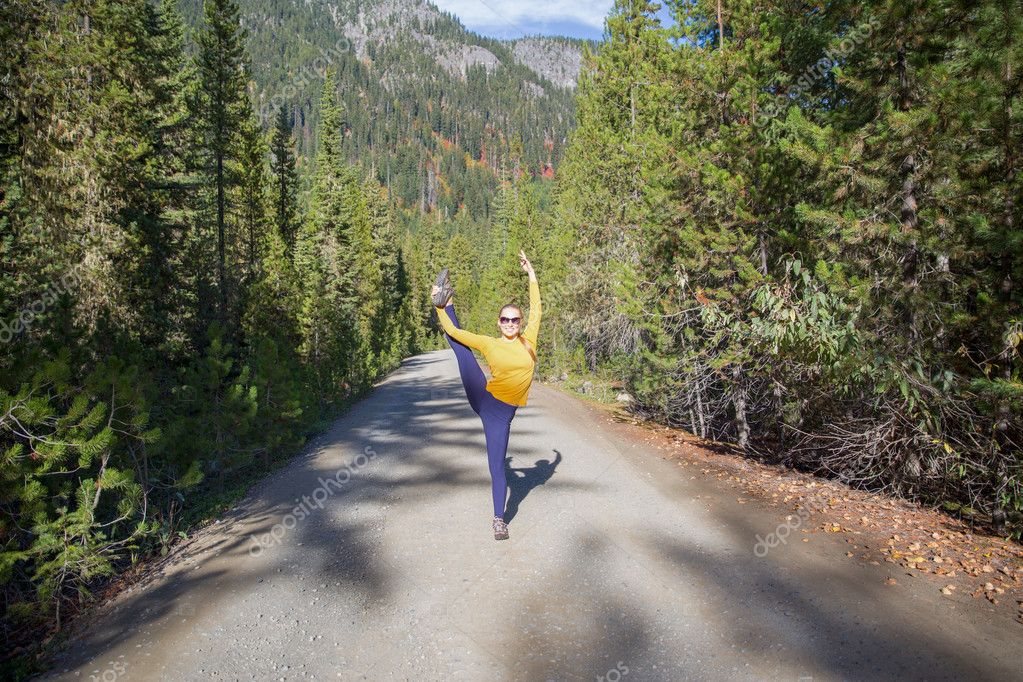 Young fitness woman practice yoga in the mountains