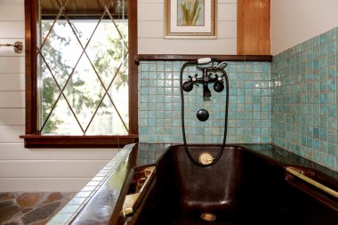 Bathroom interior in a luxurious wooden cabin.