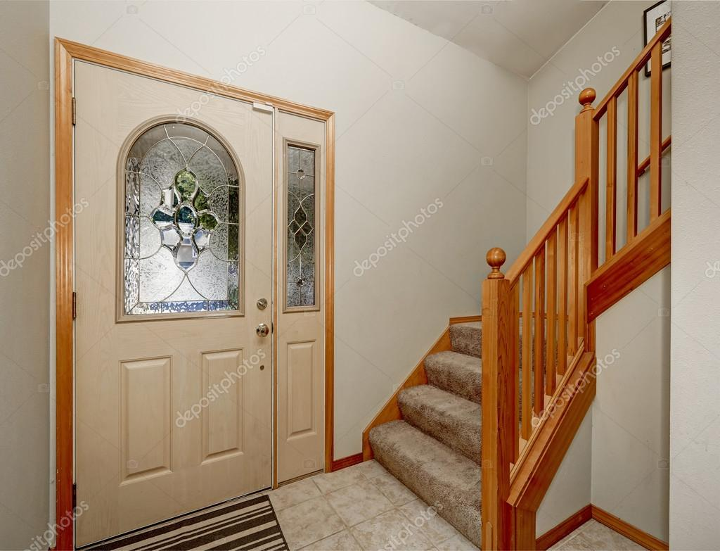 View of wooden staircase and tile floor house entryway stock view of wooden staircase and tile floor house entryway stock photo dailygadgetfo Gallery