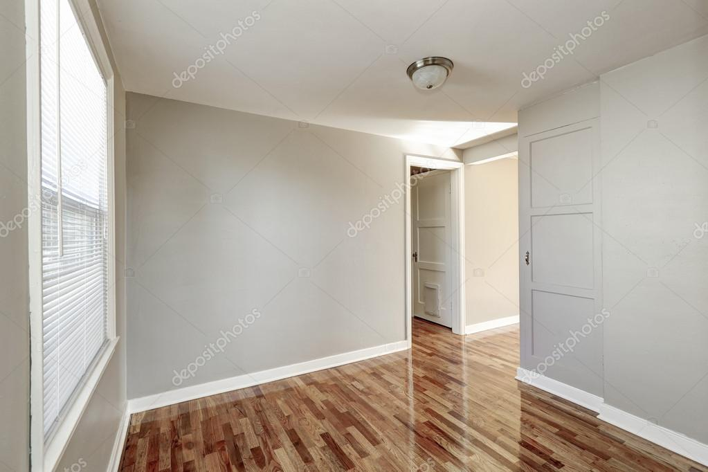 Empty Beige Hallway Interior And Hardwood Floor Stock
