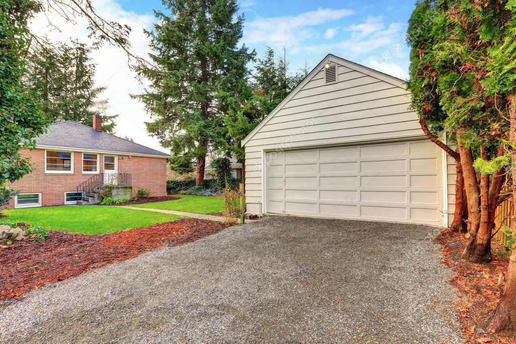 Detached garage of the red brick house stock photo for Brick garages prices