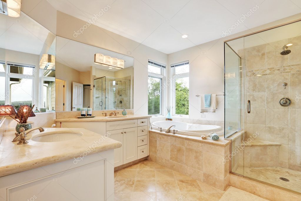 Master Bathroom Interior With Beige Tile Floor Stock