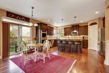 Cozy kitchen and dining room interior with hardwood floor