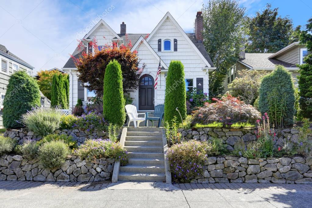American craftsman style home with beautiful landscape design
