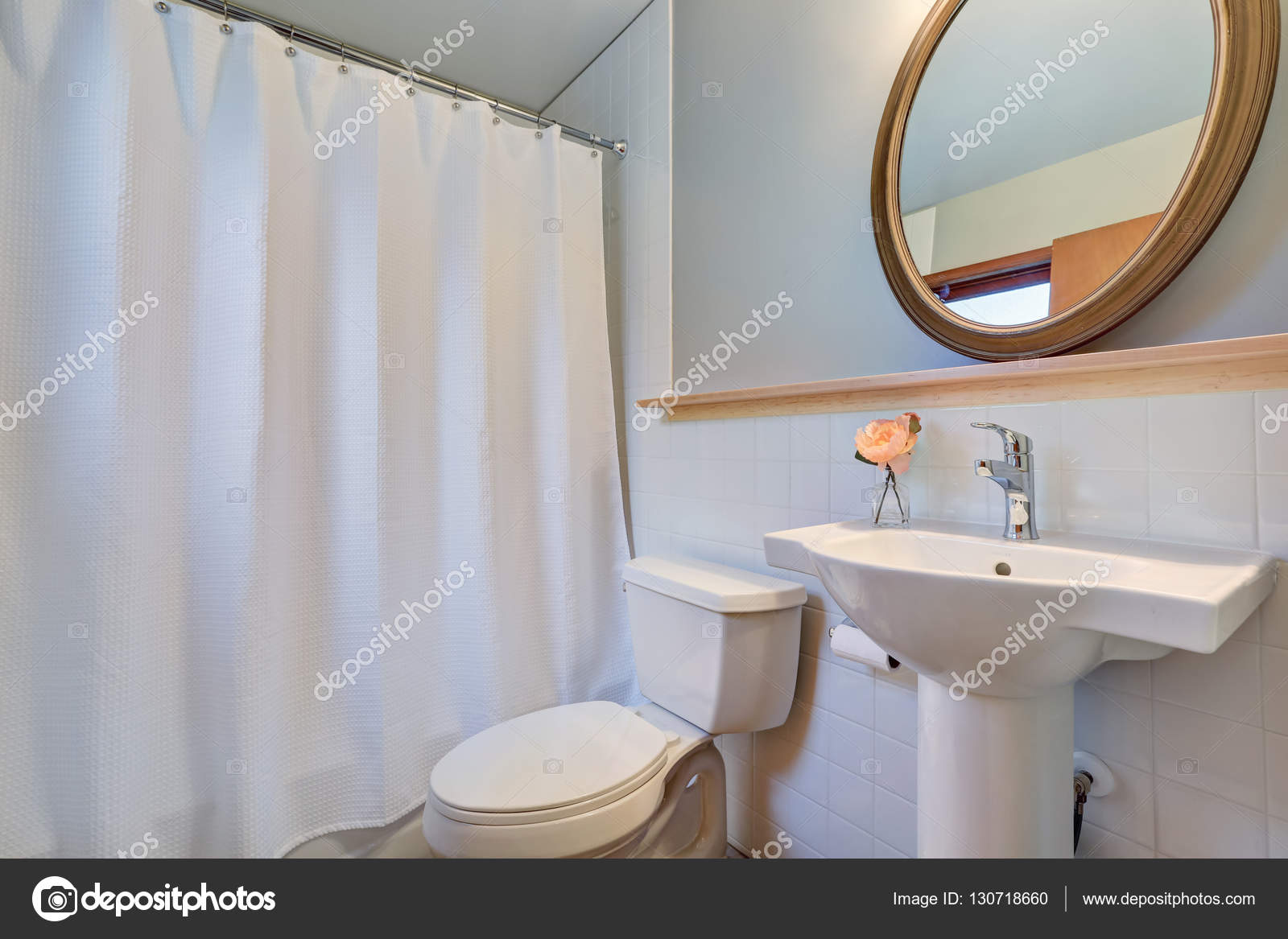 White clean bathroom with washbasin stand and a toilet. — Stock ...