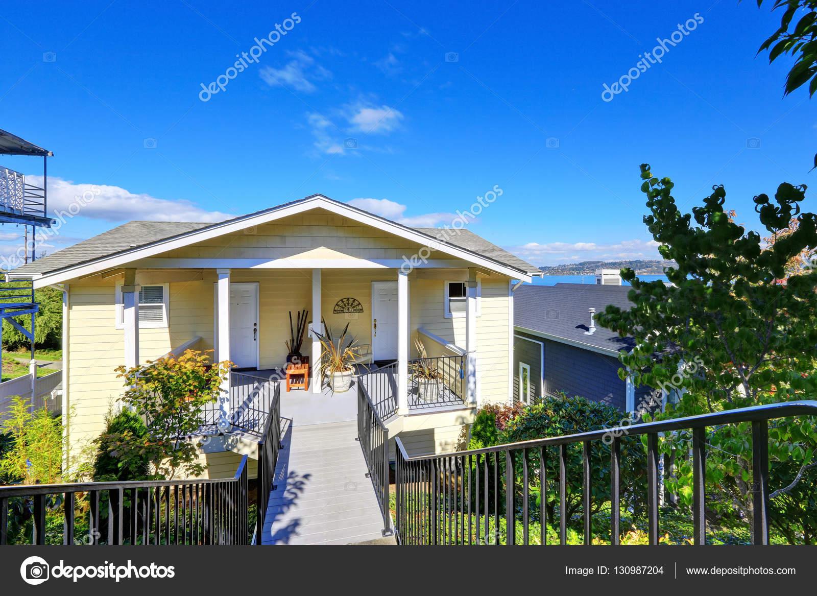 american yellow duplex house on blue sky background stock photo american yellow duplex house on blue sky background northwest usa photo by iriana88w