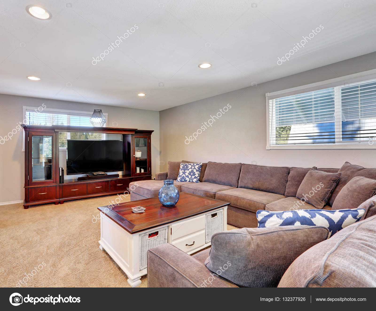 Wondrous Cozy Family Room With Brown Sectional Sofa Stock Photo Creativecarmelina Interior Chair Design Creativecarmelinacom