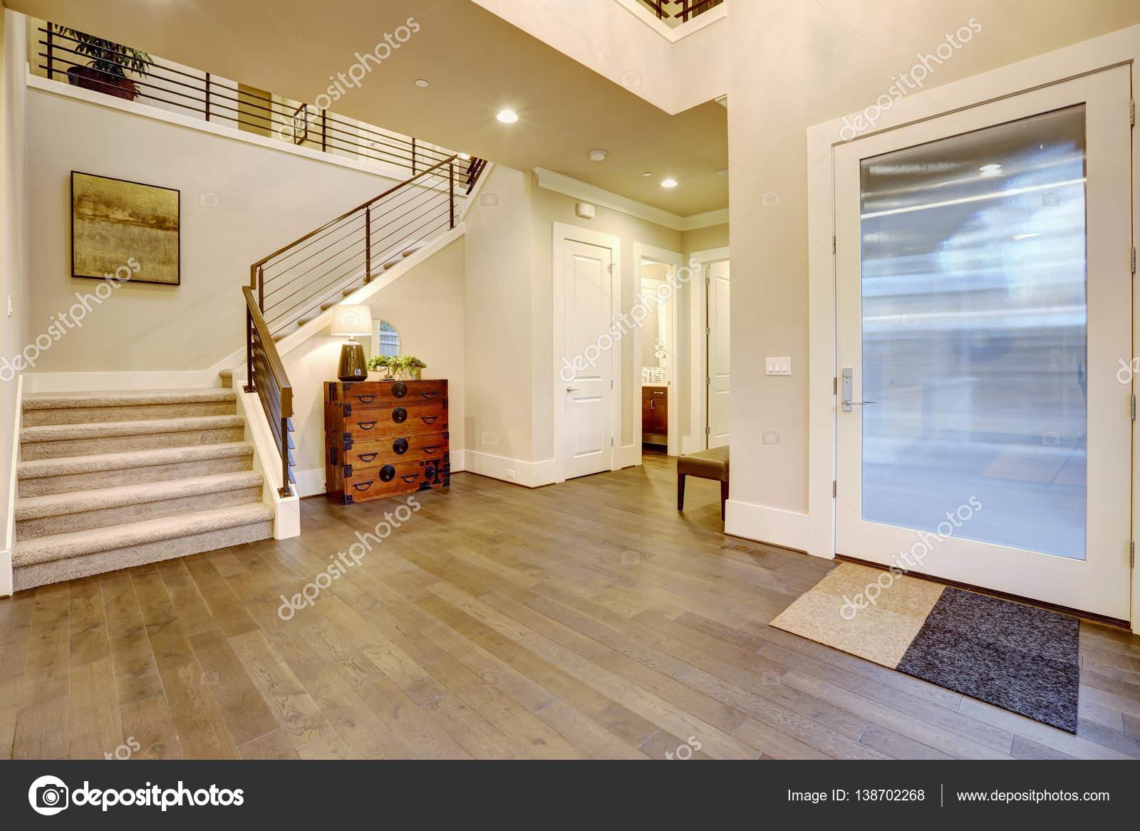 Foyer Design St Sauveur : Light modern foyer design boasts steamer trunk dresser