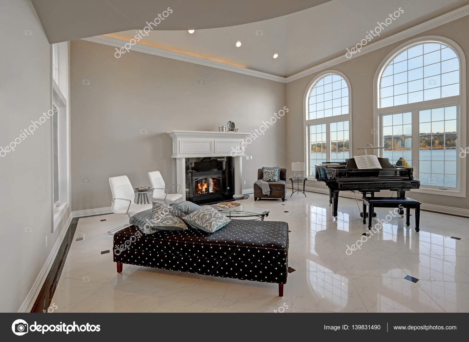 Luxury high ceiling living room with marble floor stock photo