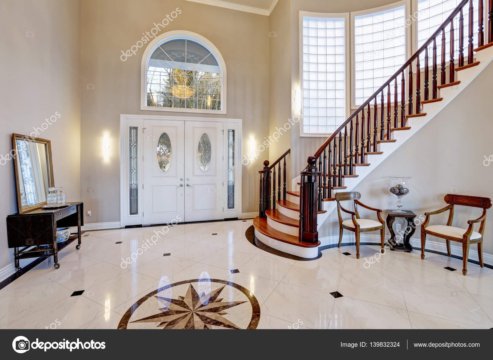 Stunning two story entry foyer with marble mosaic tiled floor stunning two story entry foyer with lots of space boasts marble mosaic tile floor front door framed with arch window and sidelights grand staircase with dailygadgetfo Gallery