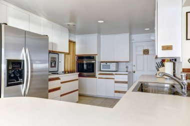 Compact kitchen room with white cabinetry