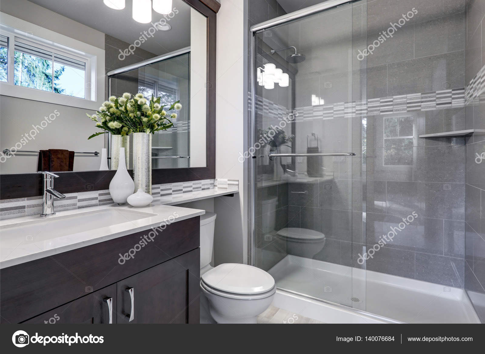 https://st3.depositphotos.com/1041088/14007/i/1600/depositphotos_140076684-stock-photo-bright-new-bathroom-interior-with.jpg