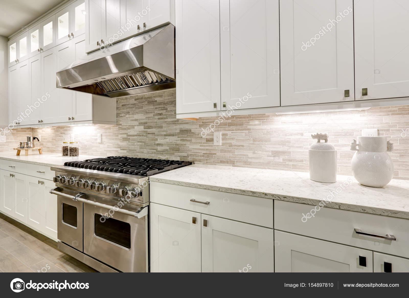 Gourmet kitchen features white cabinetry — Stock Photo © iriana88w ...