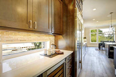 Luxury kitchen with a glass door wine cooler