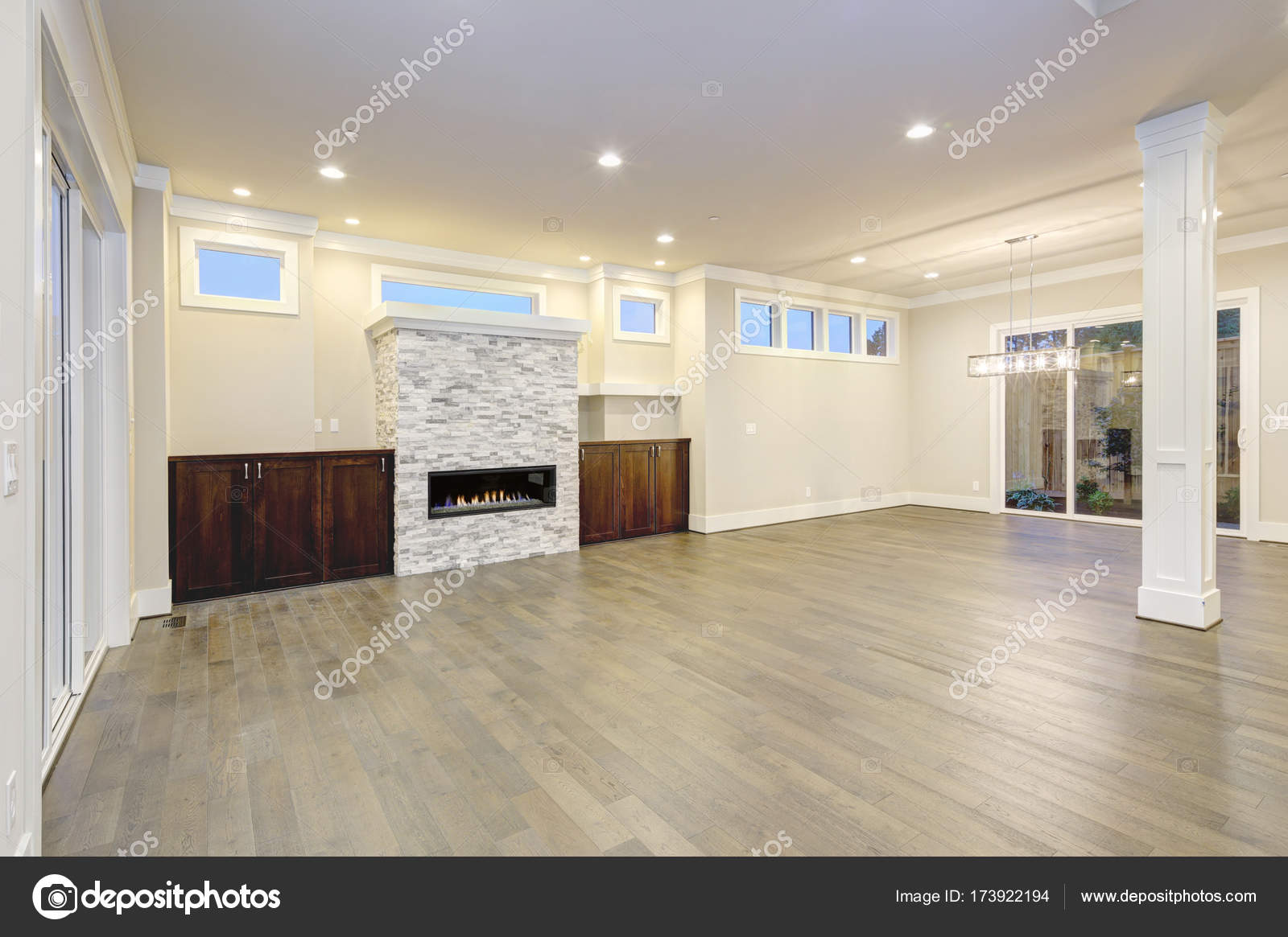 Spacious empty living room interior in white and gray colors ...