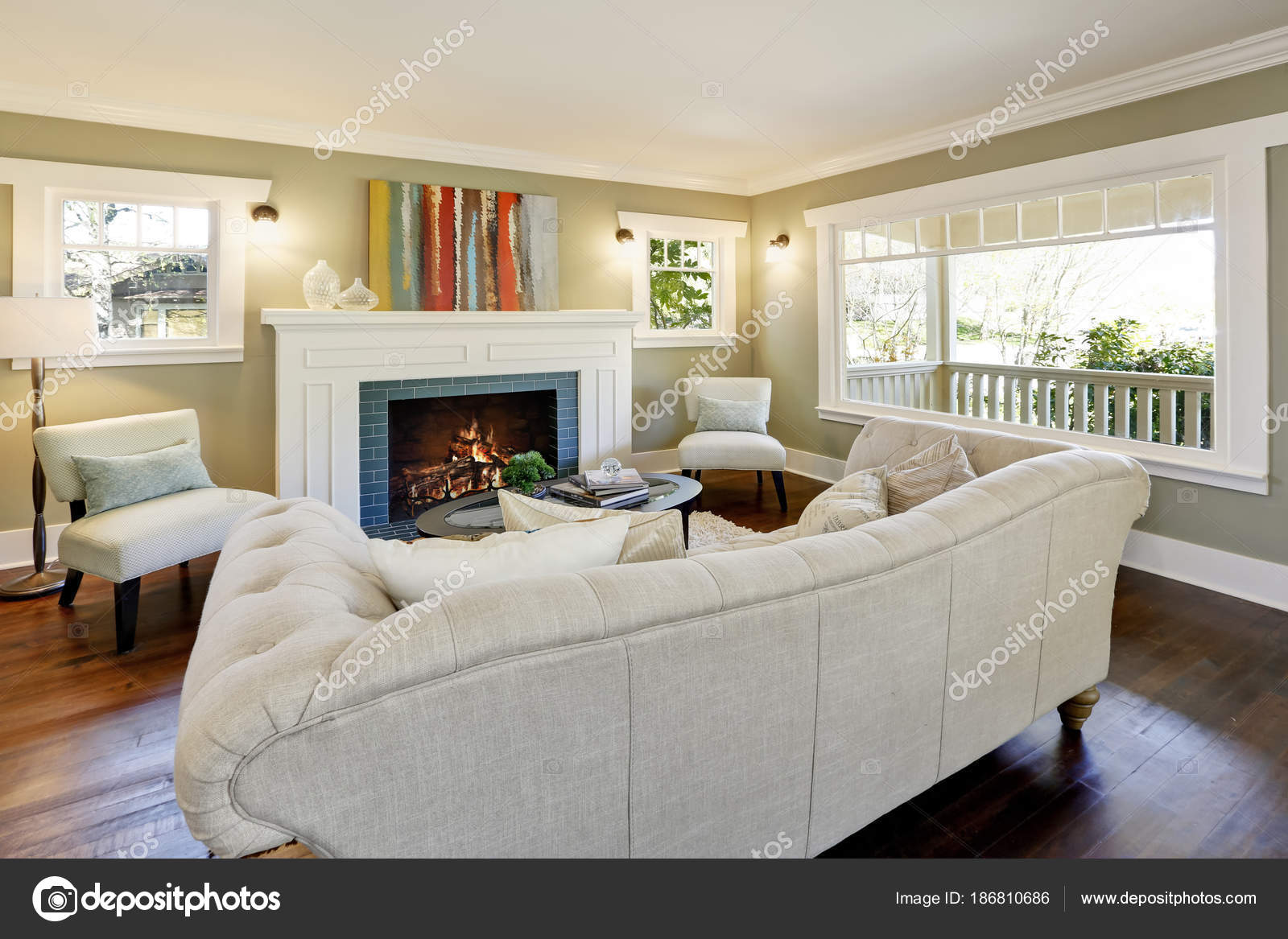 Chic Green Living Room With A Traditional Fireplace Stock
