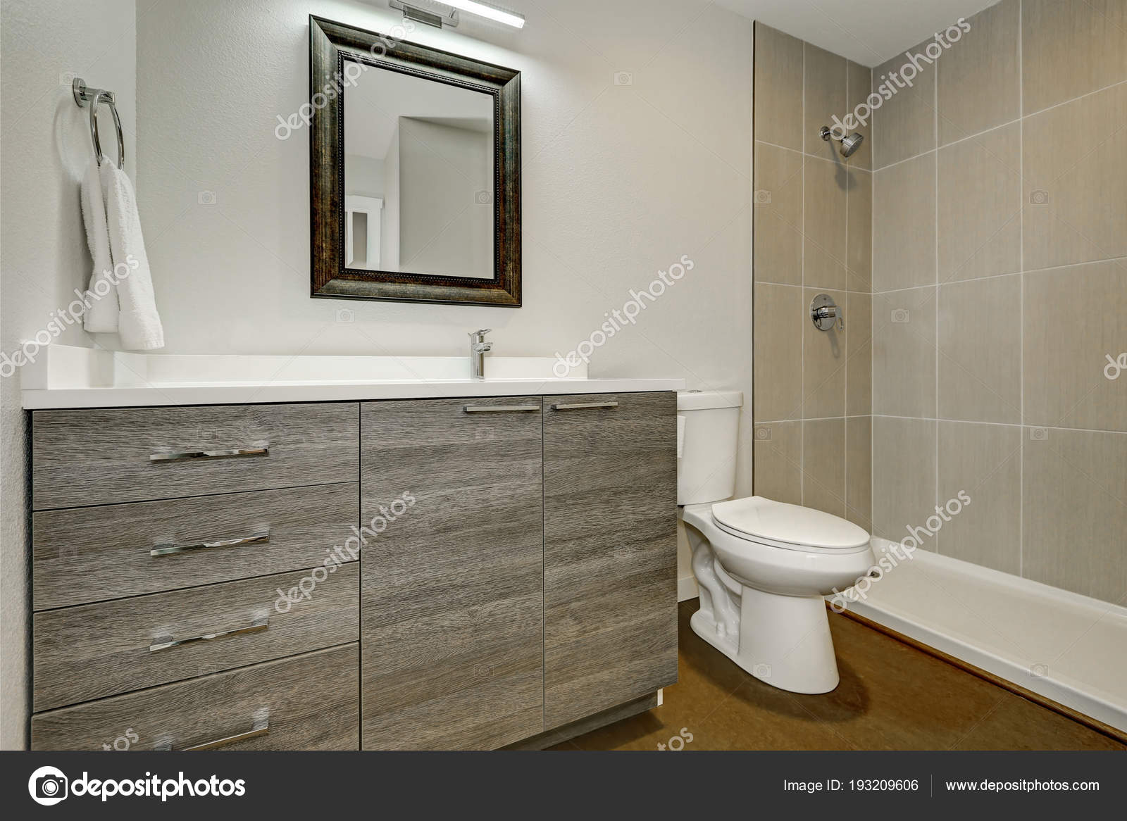 https://st3.depositphotos.com/1041088/19320/i/1600/depositphotos_193209606-stock-photo-new-grey-bathroom-interior-design.jpg