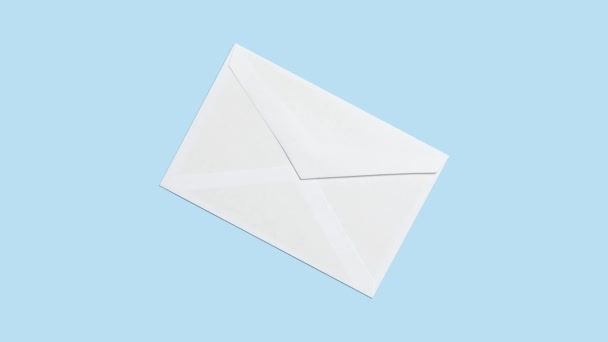 yellow note comes out of white envelope, stop motion