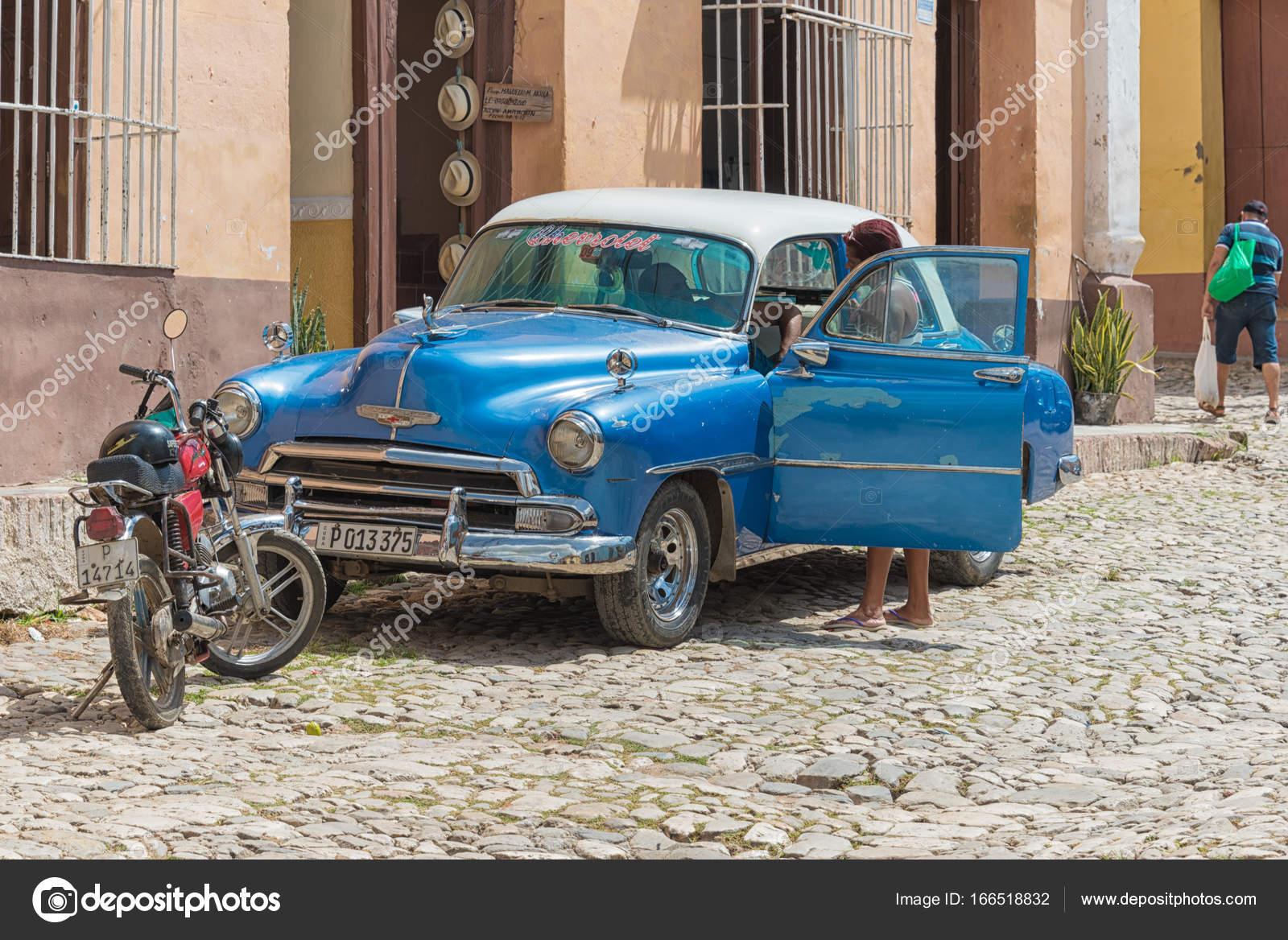 Trinidad,Cuba: Old Chevrolet car in cobblestone street – Stock ...