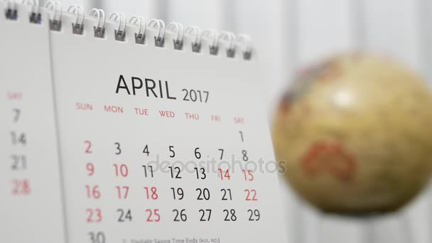 Motion of April 2017 calendar with blur earth globe turning background