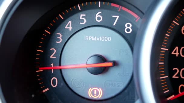 Motion of start engine car and focus on car tachometer