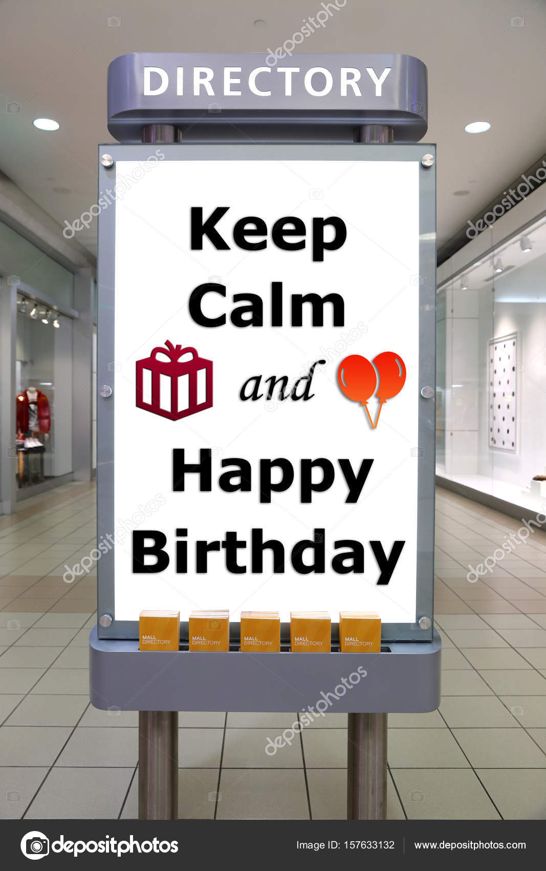 keep calm and happy birthday sign inside shopping mall stock photo