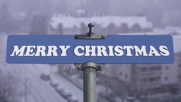 Merry Christmas road sign on cold blizzard snow winter time