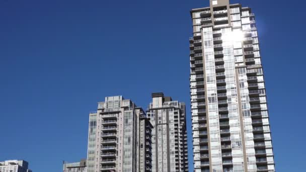 Motion of high-rise residential new buildings on blue sky