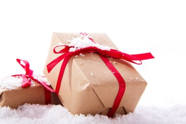 Christmas presents in brown paper with red ribbon