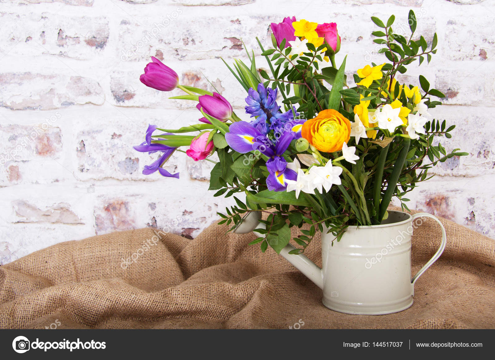 Spring Flower Arrangement Against A Rustic Background Stock Photo