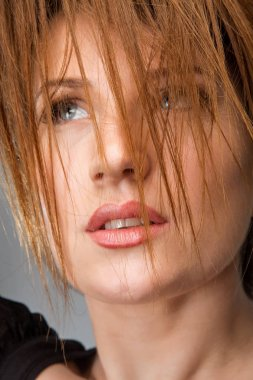 Beautiful Woman With Brown reddish Hair. Haircut. Hairstyle. Professional Makeup
